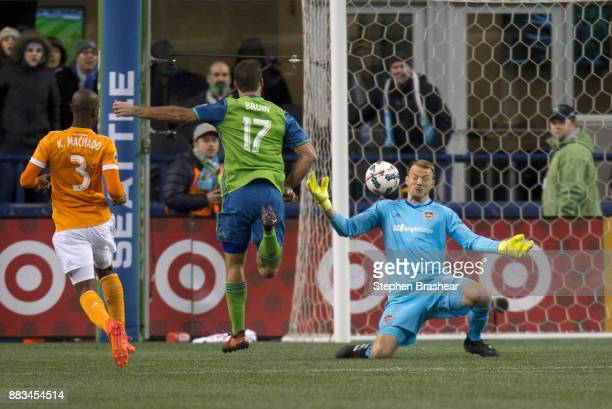 Goalkeeper Joe Willis of the Houston Dynamo is unable to make a save on a shot by Will Bruin of the Seattle Sounders as Adolfo Machado of the Houston...
