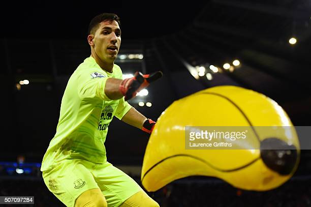 Goalkeeper Joel Robles of Everton removes an inflatable banana from the pitch during the Capital One Cup Semi Final second leg match between...