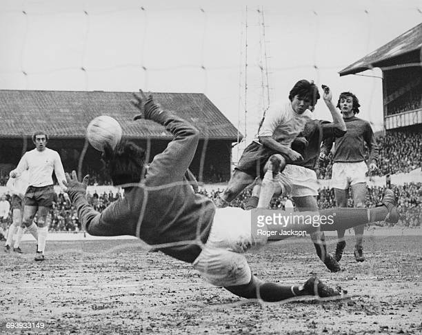 Goalkeeper John Jackson of Crystal Palace dives in vain to stop the shot on goal from Spurs defender Steve Perryman as Crystal Palace defender Steve...