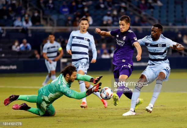 Goalkeeper John Pulskamp of Sporting Kansas City blocks a shot by Rodrigo Schlegel of Orlando City during the 1st half of the Major League Soccer...