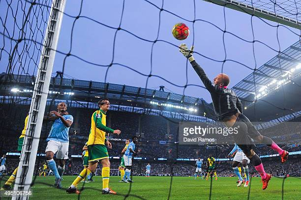 Goalkeeper John Ruddy of Norwich City fails to stop Nicolas Otamendi of Manchester City from scoring their first goal during the Barclays Premier...
