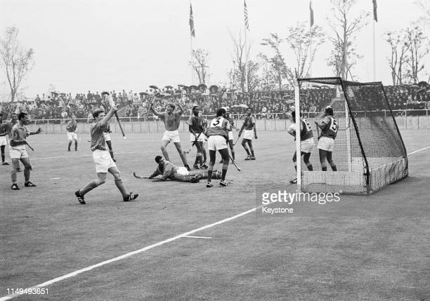 Goalkeeper John Simonian of Kenya looks on behind as Frank Zweerts of the Netherlands scores during their Men's Olympic Field Hockey Tournament match...