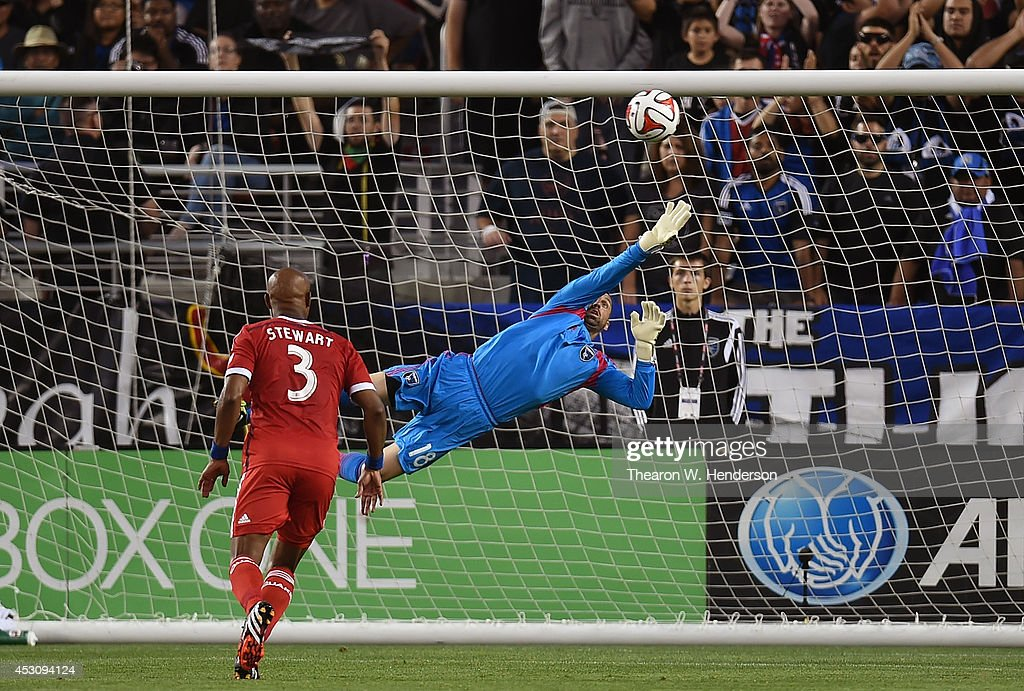 Goalkeeper Jon Busch #18 of the San Jose Earthquakes makes a save against the Seattle Sounders FC during the first half of an MLS Soccer game at Levi's Stadium on August 2, 2014 in Santa Clara, California.