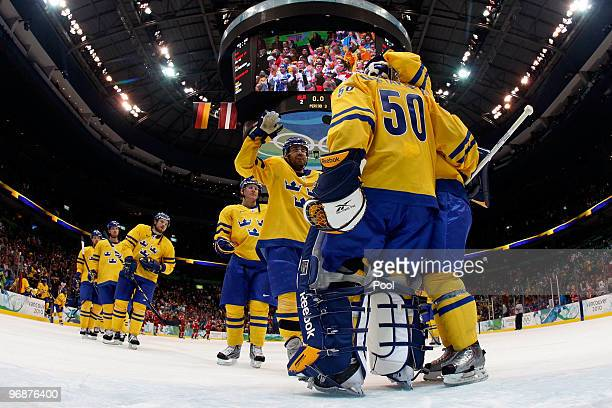 Goalkeeper Jonas Gustavsson of Sweden celebrate after with his team defeating Belarus 42 during the ice hockey men's preliminary game on day 8 of the...