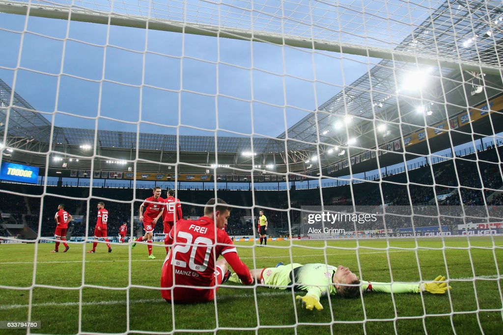 Goalkeeper Jonas Loessl and Fabian Frei of Mainz react after Marco Terrazzino of Hoffenheim scored his team's second goal during the Bundesliga match between TSG 1899 Hoffenheim and 1. FSV Mainz 05 at Wirsol Rhein-Neckar-Arena on February 4, 2017 in Sinsheim, Germany.