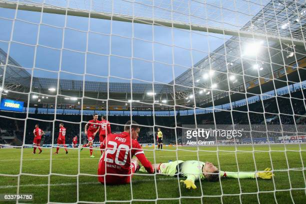Goalkeeper Jonas Loessl and Fabian Frei of Mainz react after Marco Terrazzino of Hoffenheim scored his team's second goal during the Bundesliga match...
