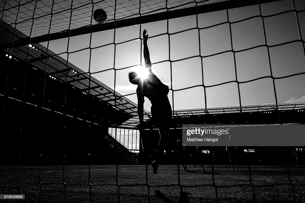 Goalkeeper Jonas Loessl of Mainz saves a ball during the Bundesliga match between 1. FSV Mainz 05 and SV Darmstadt 98 at Opel Arena on October 16, 2016 in Mainz, Germany.