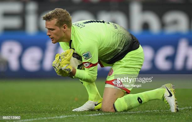Goalkeeper Jonas Loessl of Mainz saves a ball during the Bundesliga match between 1 FSV Mainz 05 and RB Leipzig at Opel Arena on April 5 2017 in...