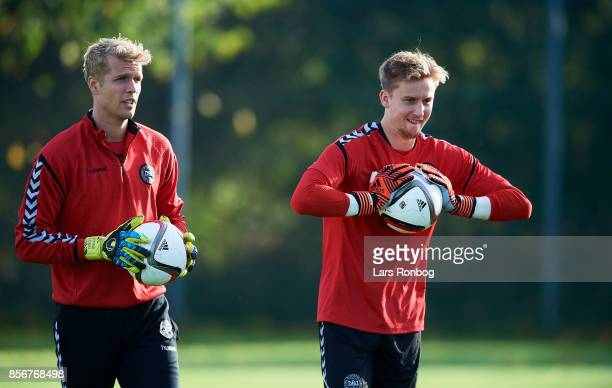 Goalkeeper Jonas Lossl and Frederik Ronnow in action during the Denmark training Session at Dragor Stadion on October 2 2017 in Dragor Denmark
