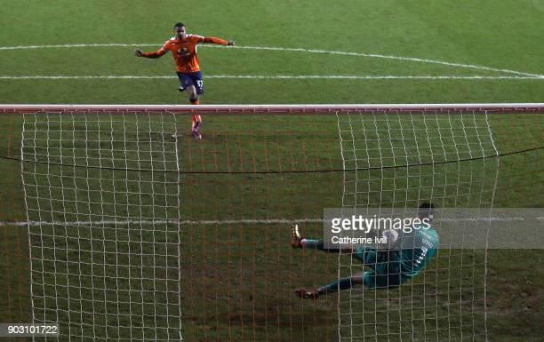 Goalkeeper Jonathan Bond of Peterborough United saves the penalty taken by Frankie Musonda of Luton Town during the EFL Checkatrade Trophy Third...