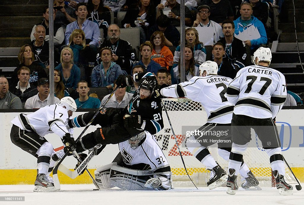 Goalkeeper Jonathan Quick #32, Rob Scuderi #7, Matt Greene #2 and Jeff Carter #77 of the Los Angeles Kings defends the net against TJ Galiardi #21 of the San Jose Sharks in the first period in Game Four of the Western Conference Semifinals during the 2013 NHL Stanley Cup Playoffs at HP Pavilion on May 21, 2013 in San Jose, California.