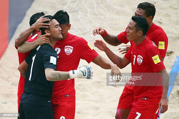 Goalkeeper Jonathan Torohia of Tahiti celebrates a goal with team mates during the FIFA Beach Soccer World Cup Portugal 2015 Group D match between...