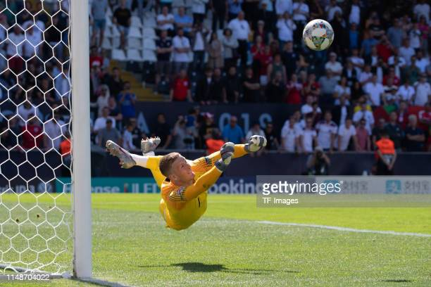 Goalkeeper Jordan Pickford of England controls the ball during the UEFA Nations League Third Place Playoff match between Switzerland and England at...