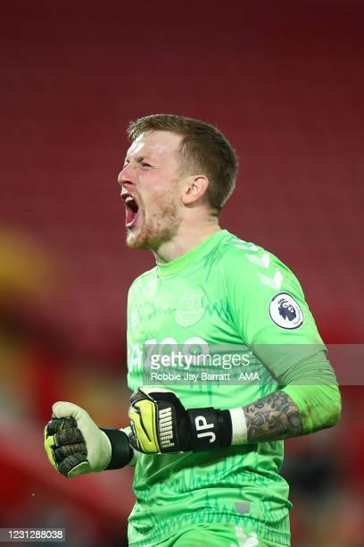 Goalkeeper Jordan Pickford of Everton celebrates victory in the Merseyside Derby during the Premier League match between Liverpool and Everton at...