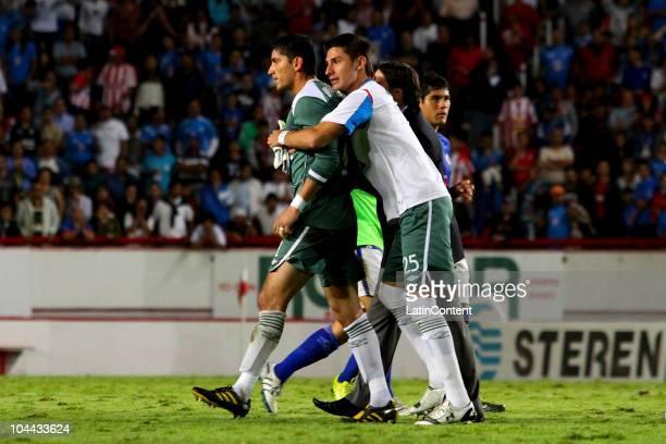 Goalkeeper Jose de Jesus Corona and player Yosgart Gutierrez of Cruz Azul react during a match against Necaxa as part of the Apertura 2010 at...