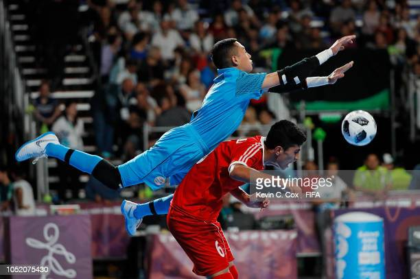 Goalkeeper Jose Mairena of Costa Rica blocks a pass over top of Belal Esmaeili of IR Iran in the Men's Futsal Group B match between Costa Rica and IR...