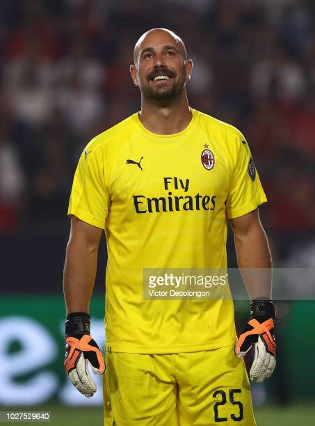 Goalkeeper Jose Reina of AC Milan makes a save during the penalty shootout against Manchester United in the International Champions Cup 2018 match at...