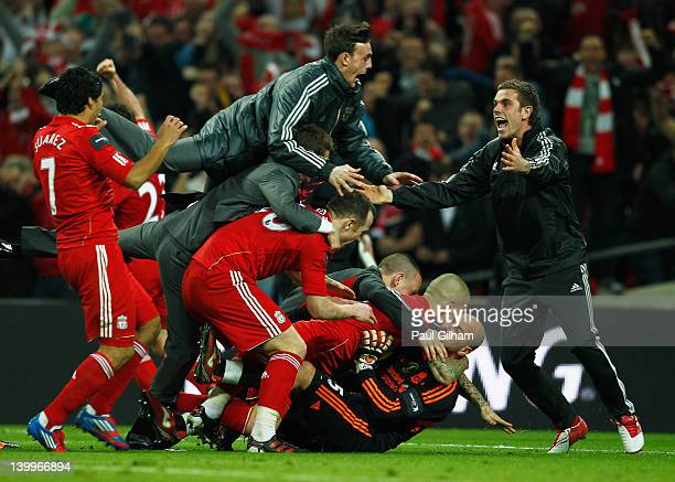 Goalkeeper Jose Reina of Liverpool is mobbed by team mates as they celebrate their penalty shoot out victory after the Carling Cup Final match...