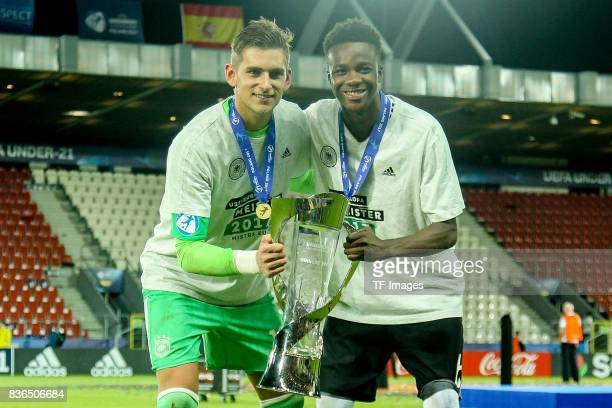 Goalkeeper Julian Pollersbeck of Germany Gideon Jung of Germany celebrates with the trophy after the UEFA U21 Final match between Germany and Spain...
