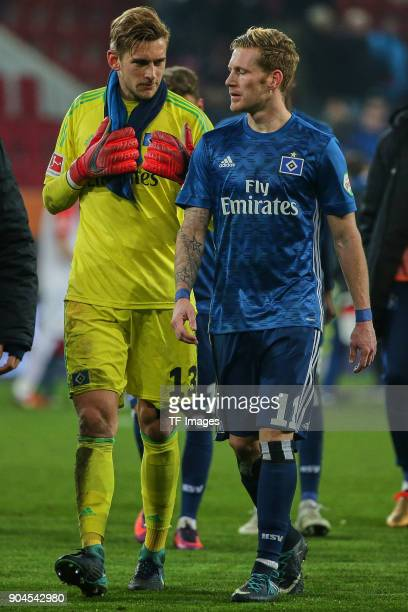 Goalkeeper Julian Pollersbeck of Hamburg and Andre Hahn of Hamburg look dejected after the Bundesliga match between FC Augsburg and Hamburger SV at...