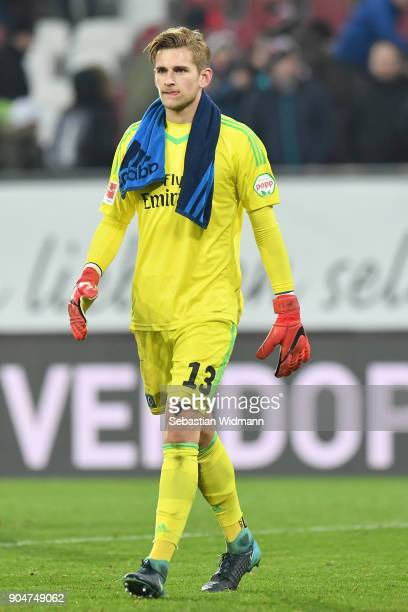Goalkeeper Julian Pollersbeck of Hamburg leaves the pitch after the Bundesliga match between FC Augsburg and Hamburger SV at WWKArena on January 13...