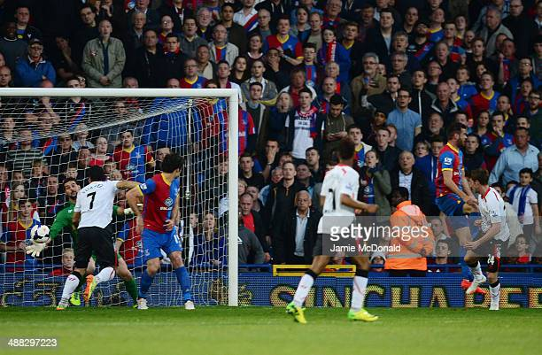 Goalkeeper Julian Speroni of Crystal Palace dives in vain as Joe Allen of Liverpool scores the opening goal during the Barclays Premier League match...