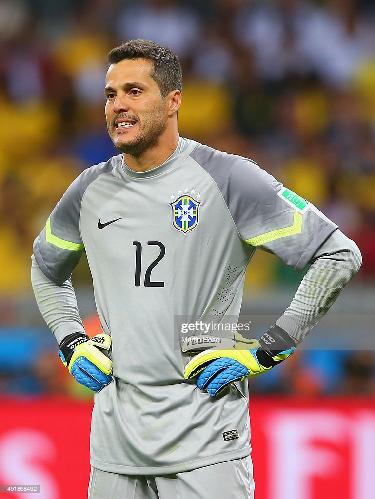 Goalkeeper Julio Cesar of Brazil looks dejected after ...