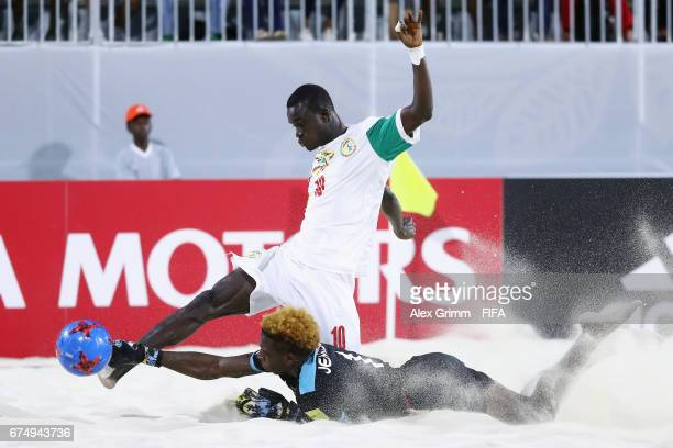 Goalkeeper Julio Jemison of Bahamas makes a save against Mamour Diagne of Senegal during the FIFA Beach Soccer World Cup Bahamas 2017 group A match...