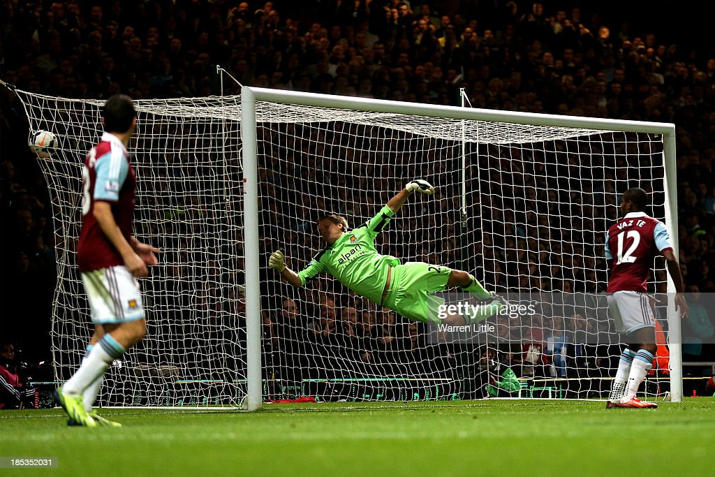 Goalkeeper Jussi Jaaskelainen of West Ham dives in vain as he is beaten by the shot from Sergio Aguero (not shown) of Manchester City to go 2-0 down during the Barclays Premier League match between West Ham United and Manchester City at Boleyn Ground on October 19, 2013 in London, England.