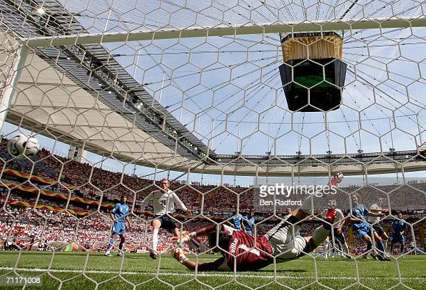 Goalkeeper Justo Villar of Paraguay dives in vain as he is beaten by an own goal from teammate Carlos Gamarra during the FIFA World Cup Germany 2006...