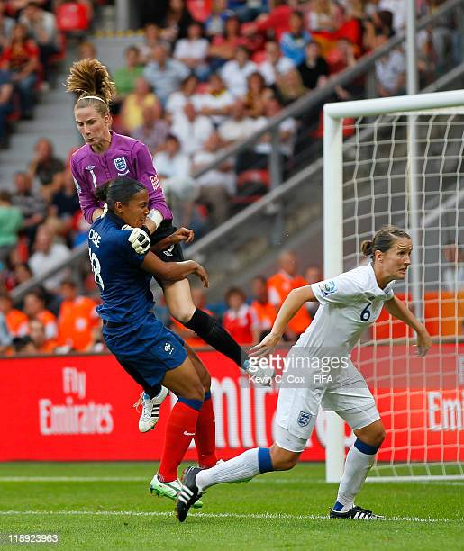 Goalkeeper Karen Bardsley of England collides with MarieLaure Delie of France during the FIFA Women's World Cup 2011 Quarter Final match between...