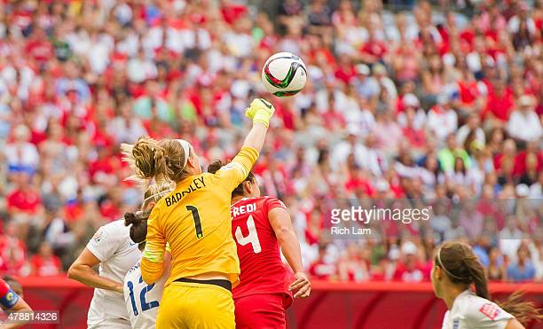 Goalkeeper Karen Bardsley of England punches the ball away from Melissa Tancredi of Canada during the FIFA Women's World Cup Canada 2015 Quarter...