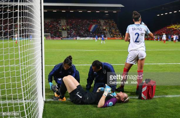 Goalkeeper Karen Bardsley of England Women is treated for an injury during the UEFA Women's Euro 2017 match between England and France at Stadion De...