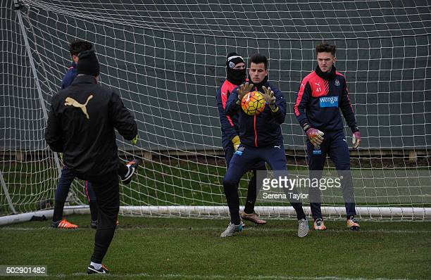 Goalkeeper Karl Darlow catches the ball whilst fellow keepers Brendon Pearson Paul Woolston and Freddie Woodman wait their turn during the Newcastle...