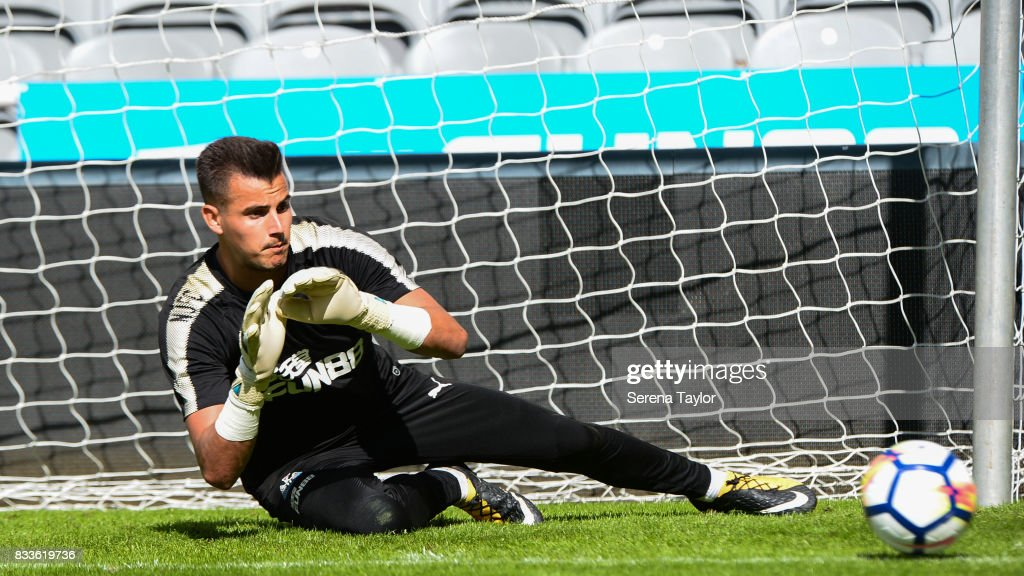 Goalkeeper Karl Darlow dives for the ball during a Newcastle United Open Training session at St.James' Park on August 17, 2017, in Newcastle upon Tyne, England.
