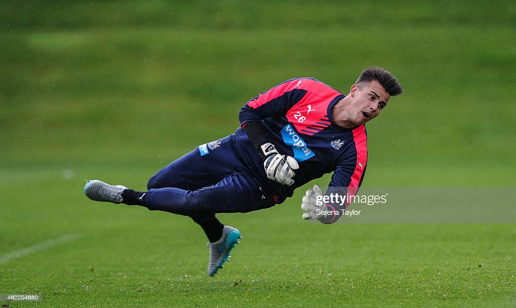Goalkeeper Karl Darlow dives for the ball during the Newcastle United Pre-Season Training session at The Newcastle United Training Centre on July 28, 2015, in Newcastle upon Tyne, England.