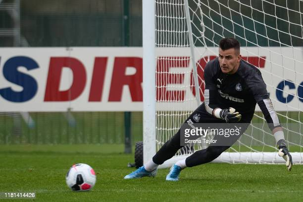 Goalkeeper Karl Darlow dives to make a save during the Newcastle United Training Session at the Newcastle United Training Centre on October 16 2019...