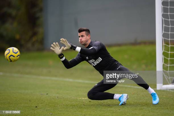 Goalkeeper Karl Darlow dives to make a save during the Newcastle United Training Session at the Newcastle United Training Centre on October 31, 2019...