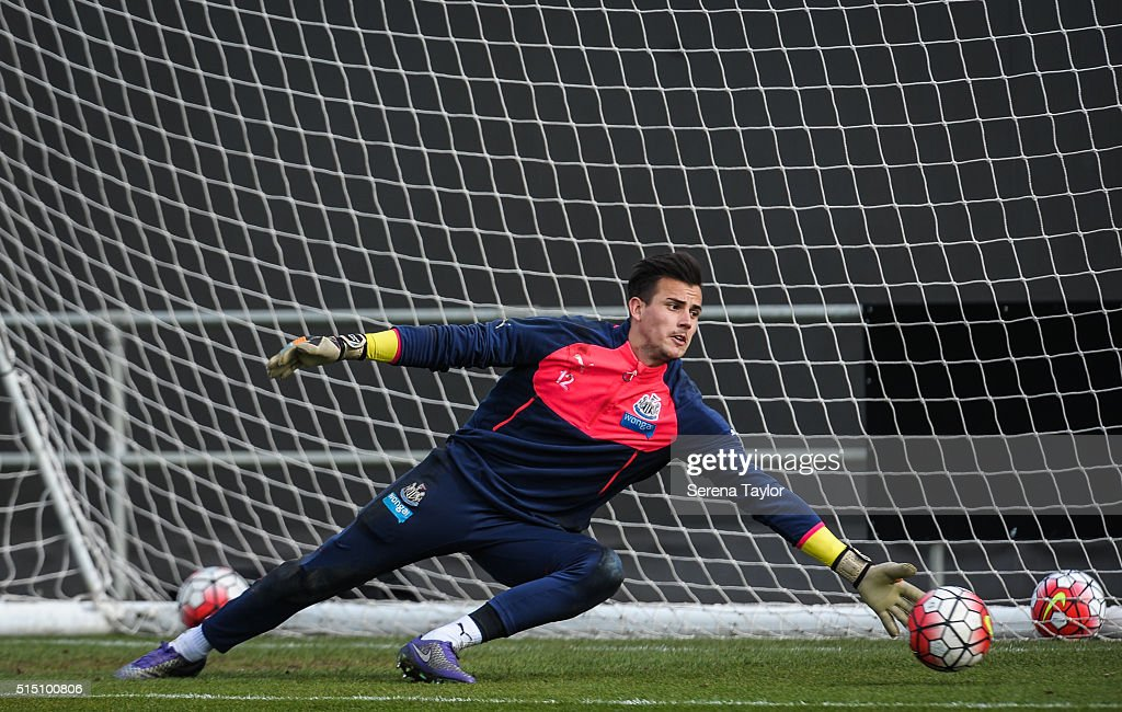 Goalkeeper Karl Darlow dives to save the ball during the Newcastle United training session at The Newcastle United Training Centre on March 12, 2016, in Newcastle upon Tyne, England.