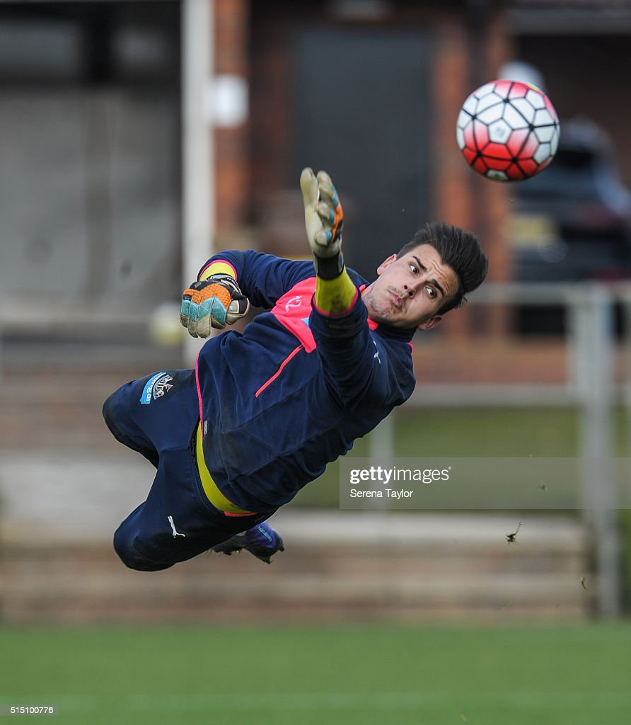 Goalkeeper Karl Darlow jumps in the air and stretches to save the ball during the Newcastle United training session at The Newcastle United Training Centre on March 12, 2016, in Newcastle upon Tyne, England.