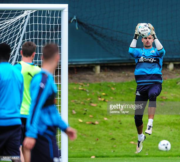 Goalkeeper Karl Darlow jumps in the air to catch the ball into play during the Newcastle United training session at the Newcastle United Training...