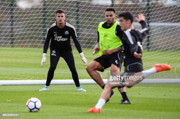 Goalkeeper Karl Darlow sets himself as Mikel Merino looks to strike the ball during the Newcastle United Training session at the Newcastle United...