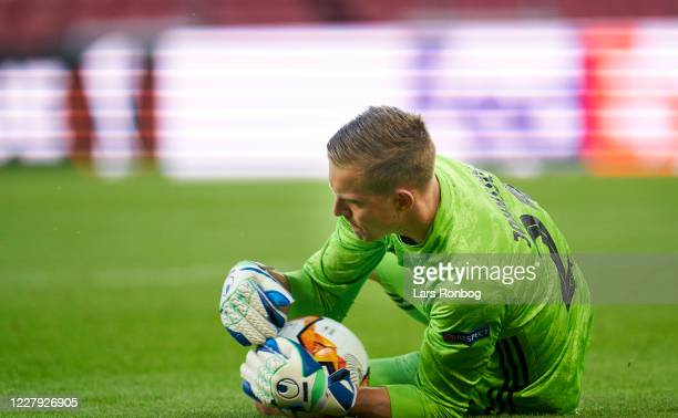 Goalkeeper Karl-Johan Johnsson of FC Copenhagen saves the ball during the UEFA Europa League round of 16, second leg match between FC Copenhagen and...