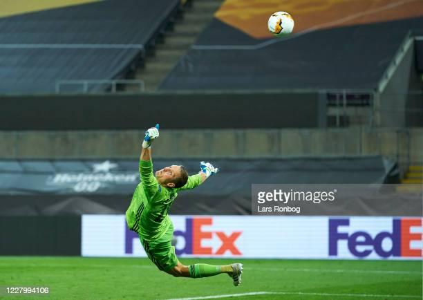 Goalkeeper Karl-Johan Johnsson of FC Copenhagen saves the ball during the UEFA Europa League Quarter Final match between Manchester United and FC...