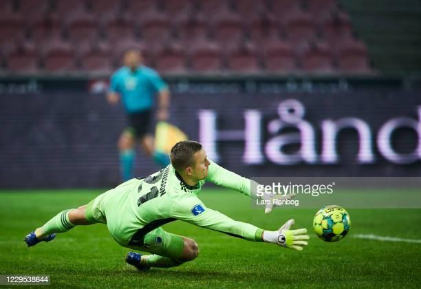 Goalkeeper Karl-Johan Johnsson of FC Copenhagen saves the ball during the Danish 3F Superliga match between FC Midtjylland and FC Copenhagen at MCH...