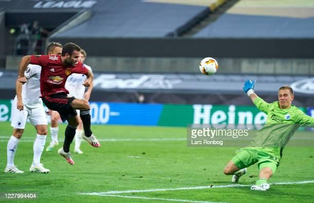 Goalkeeper Karl-Johan Johnsson of FC Copenhagen saves the short from Juan Mata of Manchester United during the UEFA Europa League Quarter Final match...