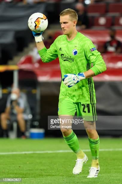 Goalkeeper Karl-Johan Johnsson of FC Kopenhagen controls the ball during the UEFA Europa League Quarter Final between Manchester United and FC...