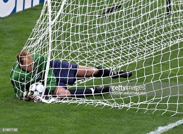US goalkeeper Kasey Keller lays on the ground with the ball after German players Andreas Moeller scoared the first goal during their 1998 Soccer...
