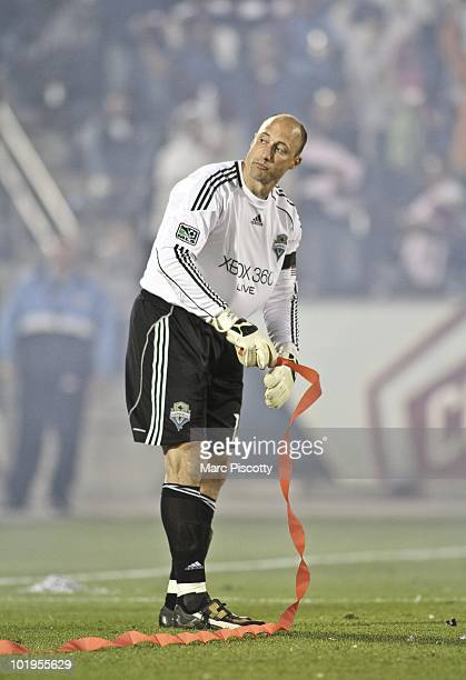 Goalkeeper Kasey Keller of the Seattle Sounders FC cleans up around the goal crease after giving up a goal against the Colorado Rapids during the...