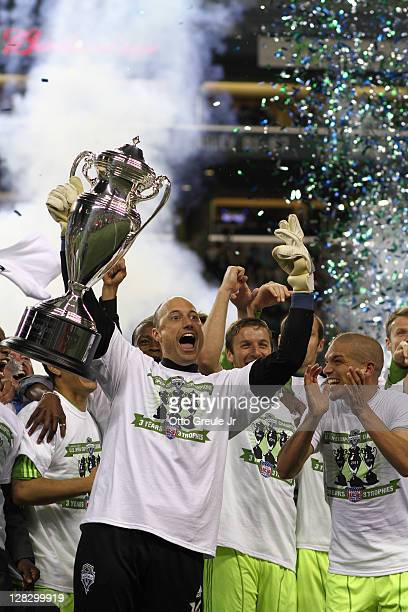 Goalkeeper Kasey Keller of the Seattle Sounders FC holds the US Open Cup trophy after defeating the Chicago Fire 20 in the 2011 Lamar Hunt US Open...